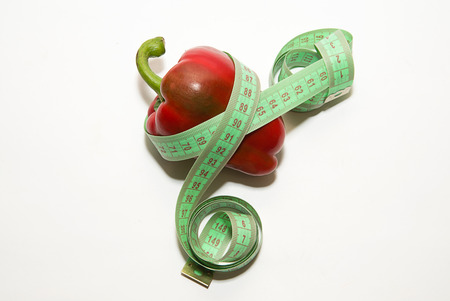garden stuff: Ripe red pepper and of tailoring meter on over white