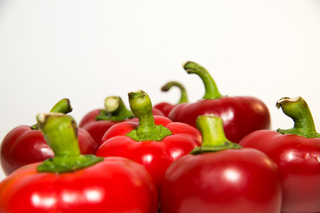 garden stuff: Many red  peppers on a white background