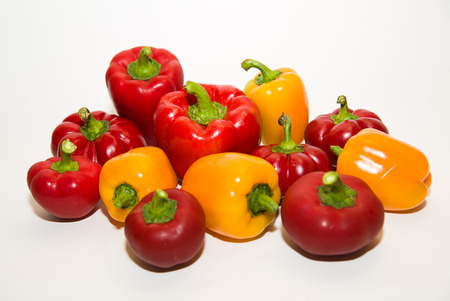 heartiness: Many red and yellow  peppers on a white background