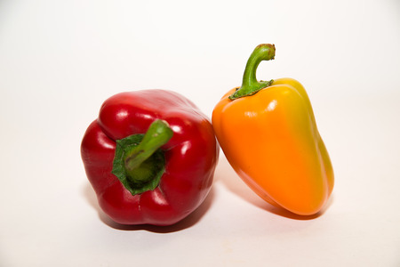 garden stuff: Two  peppers on a white background Stock Photo