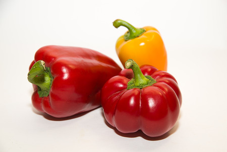 garden stuff: Three  peppers on a white background