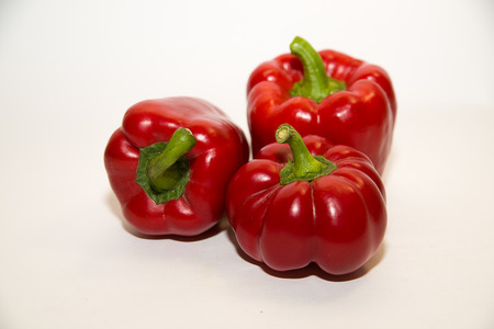heartiness: Three  peppers on a white background