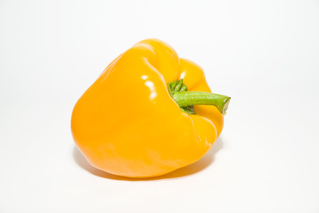 soundness: One yellow  pepper on a white background