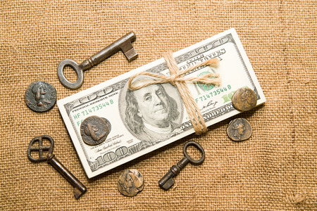 emolument: One pack of dollars tied up with rope, coins and keys  in the old cloth