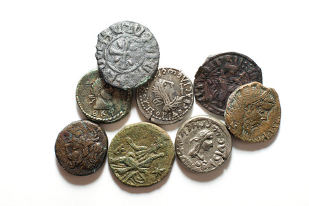 silver coins: Old silver and bronze  coins with portraits of kings on a white background
