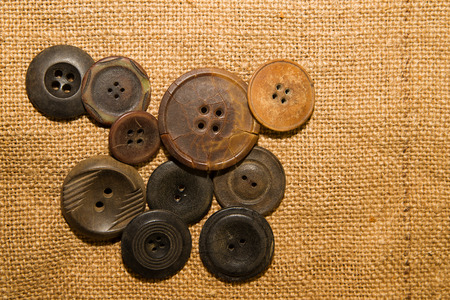 hasp: A lot of old buttons scattered on the old cloth Stock Photo