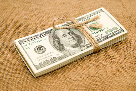 lashing: One pack of dollars tied up with rope on the old cloth