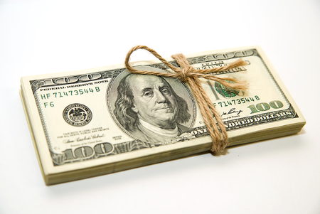 emolument: One pack of dollars tied up with rope on over white