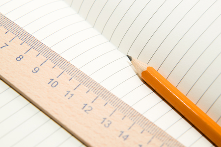 extent: Notepad with a recording sheet, pencil and wooden ruler on the old tissue Stock Photo
