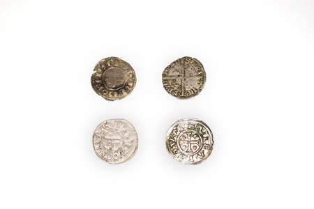 silver coins: A lot of old silver coins  on a white background