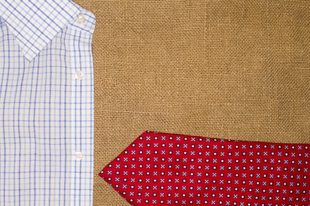 neckcloth: Red tie and plaid shirt on the old sacking Stock Photo