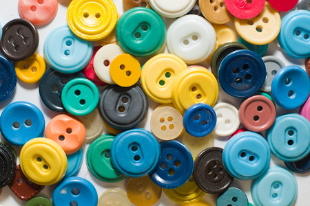 ply: A lot of old buttons  on a white background Stock Photo