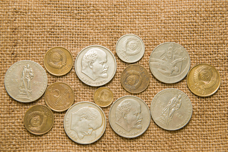 totalitarianism: A few old coins of various denominations of the Soviet Union on an old cloth