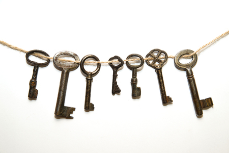 linked: Some vintage keys from the locks on a white background