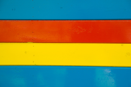 racy: A lot bright multi-colored wooden planks arranged horizontally