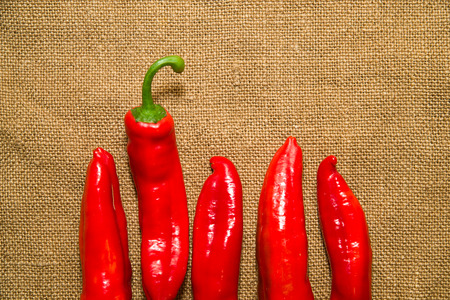 heartiness: Many red  peppers on the old cloth