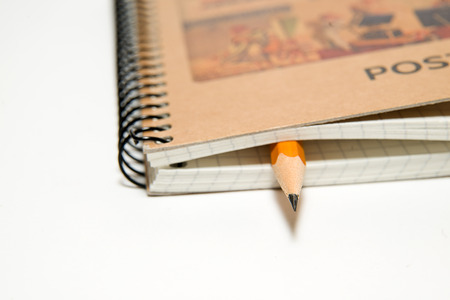 scratchpad: notebook with a blank sheet and pencil on over white