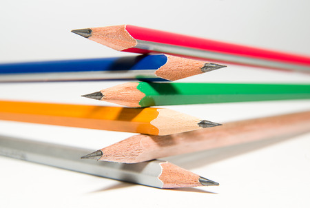 depict: Six pencils of different colors on a white Stock Photo