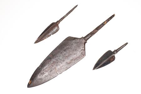 arrowheads: Three ancient iron arrowheads on a white background