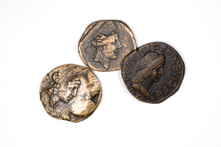 numismatics: Old bronze coins with portraits of kings on a white background Stock Photo