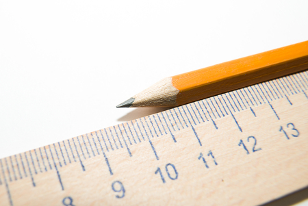 scratchpad: Notepad with a recording sheet, pencil and wooden ruler on a white background Stock Photo
