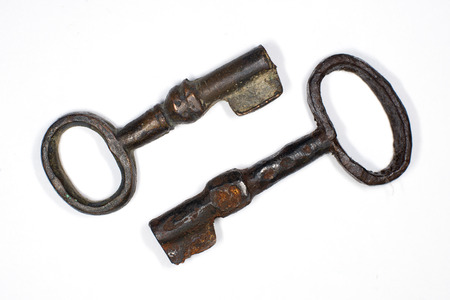 safeness: Two vintage keys to the safe on a white background
