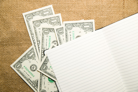 scratchpad: Opened notebook with a blank sheet and money on the old tissue Stock Photo