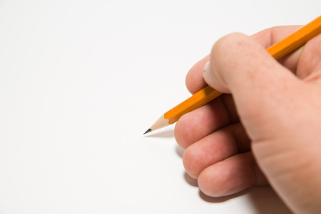 folio: Mens rigth hand holding a pencil on a white