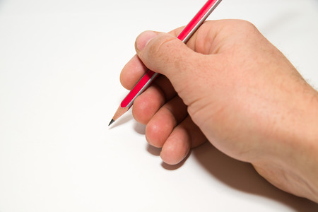 folio: Mens rihte hand holding a pencil on a white