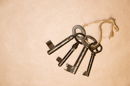 uncover: Some vintage keys on a rope on paper craft