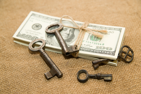 emolument: One pack of dollars tied up with rope and keys  in the old cloth