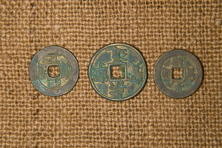 antique coins: A lot antique bronze Chinese coins on old cloth