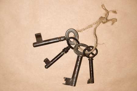 pack string: Some vintage keys on a rope on paper craft