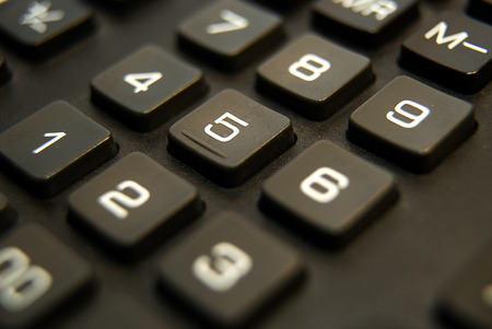 numerator: Black button device for computing close-up Stock Photo