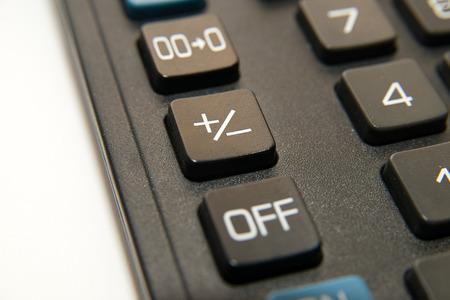 reckon: Black button device for computing close-up Stock Photo