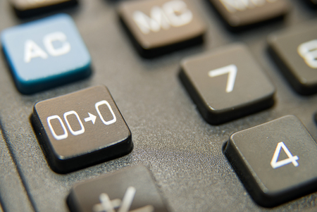 reckon: Black button of the device for computing close-up