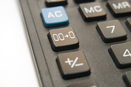 numerator: Black button of the device for computing close-up