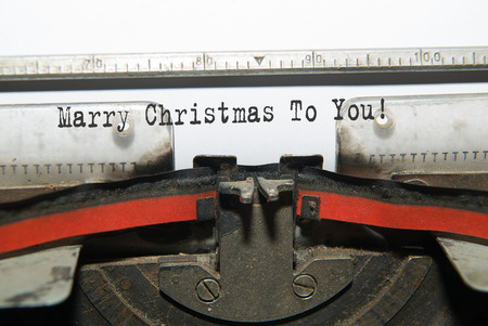 acknowledgment: Sheet of paper with the inscription Marry Christmas To You!  in the typewriter