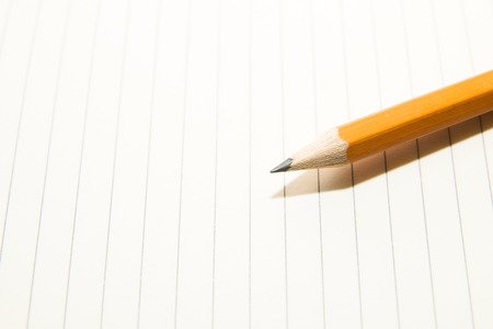 folio: Opened notebook with a blank sheet and pencisl on the old tissue Stock Photo