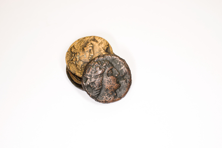 gelt: Four old coins with portraits of emperors on a white background