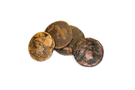 emperors: Four old coins with portraits of emperors on a white background