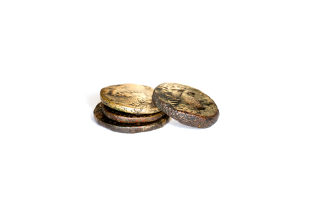 gelt: Four old coins with portraits of emperors lie one on one on a white background