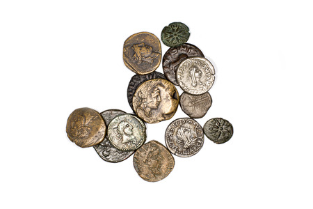 silver coins: Many ancient bronze and silver coins on a white background