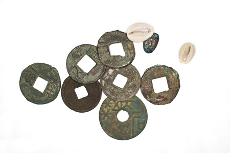 antique coins: Many antique bronze Chinese coins on a white background