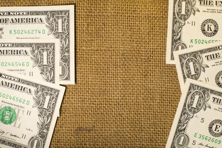 reckon: Banknotes  $1 US  dollars on the old sacking