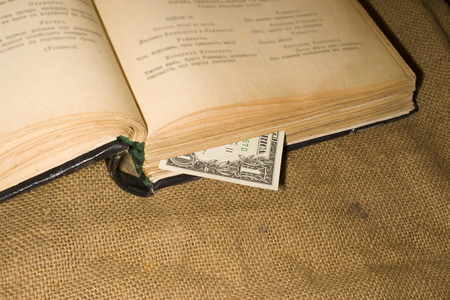 sacking: Open book with a bookmark from $ 1 on sacking