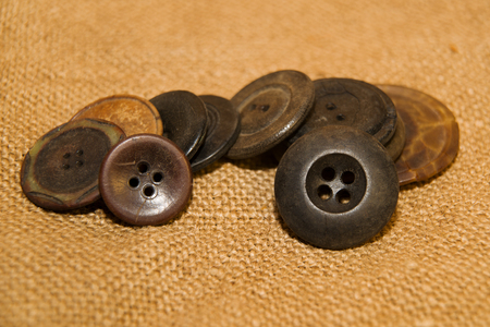 ply: A lot of old buttons scattered on the old cloth Stock Photo