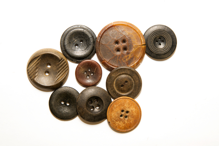 ply: A lot of old buttons scattered on white background