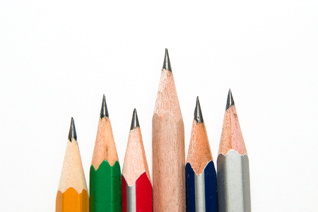 depict: Pencils of different colors on over white