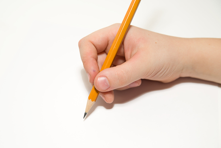 folio: Kids rigth hand holding a pencil on a white Stock Photo
